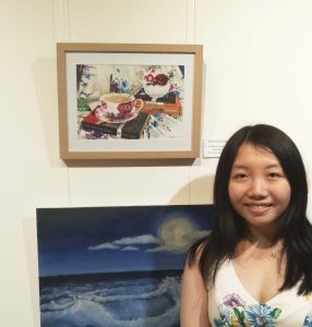 "Claudia Anne Lee with her award winning work ""Books and Bouquets""."